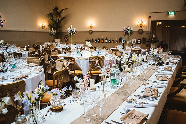 Top table for rustic wedding using hessian table runners from @theweddingomd
