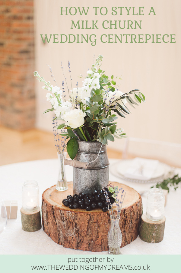 How to style a milk churn wedding centrepiece - milk churns, tree slabs and vases all available from @theweddingomd