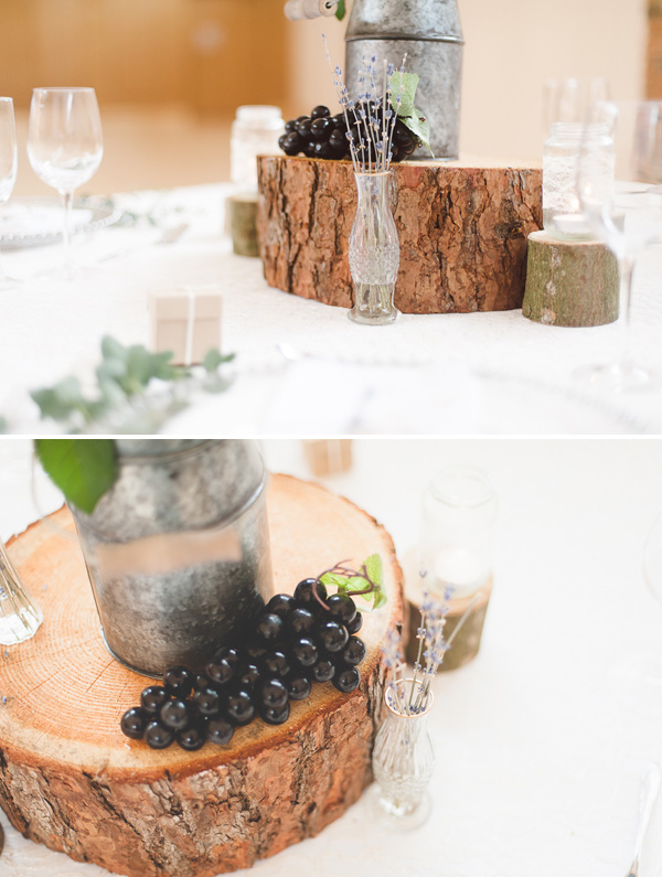Rustic wedding centrepiece with glass bottles and tree slices - available from @theweddingomd