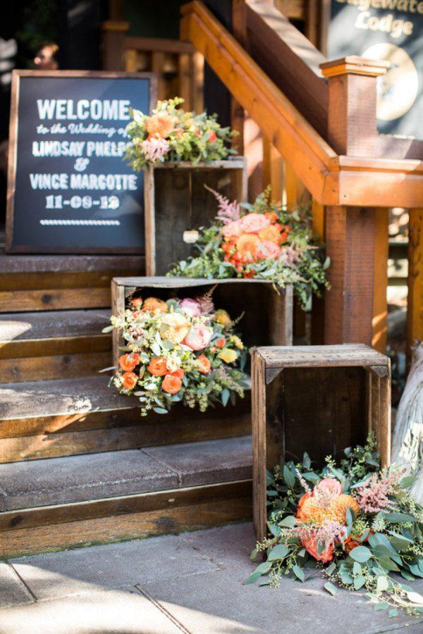 wooden crates for wedding venue entrance bellethemagazine.com - robinoneillweddings.com