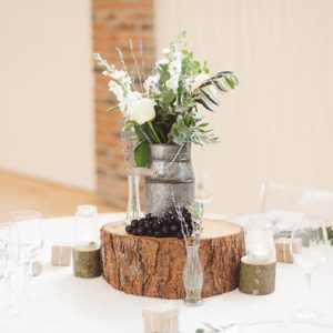 featured image How to style a milk churn wedding centrepiece - milk churns and tree slices available from @theweddingomd