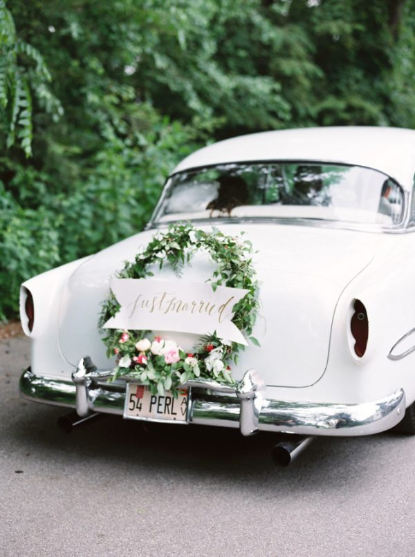 flower garlands and hoops wedding getaway cars