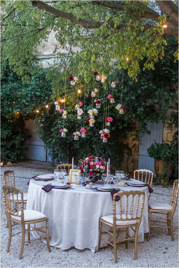 hanging vases above outdoor wedding tables - hanging vases available from @theweddingomd