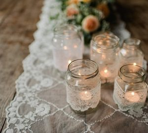 jam jar tea light holders covered in lace