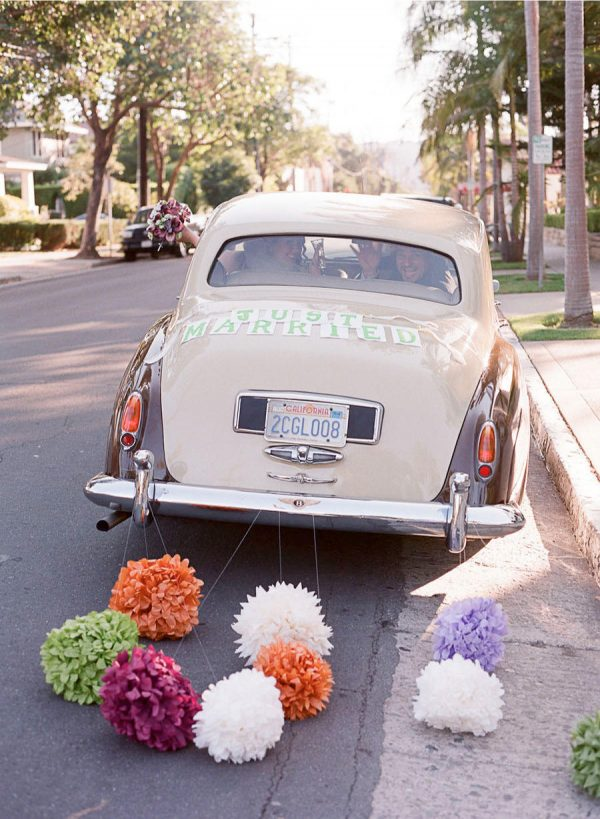 pom poms wedding getaway car decorations