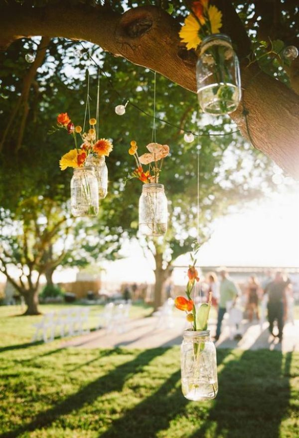beautiful idea - hanging vases from tress - hanging vases available from @theweddingomd image from stylemepretty.com - custockphotography.com