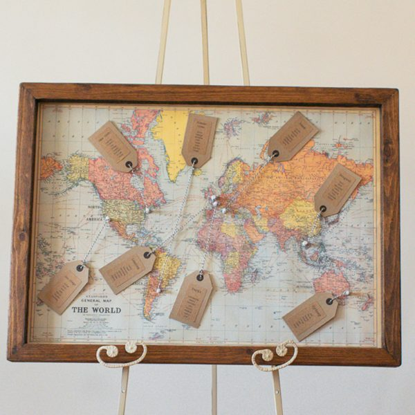 world map summer wedding table plan available from @theweddingomd