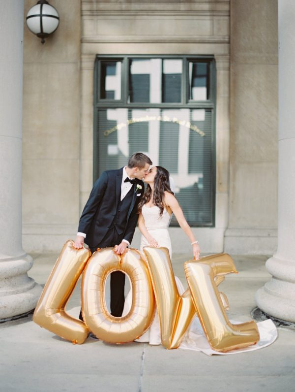 gold wedding decorations love balloons stylemepretty.com - brittamariephotography.com