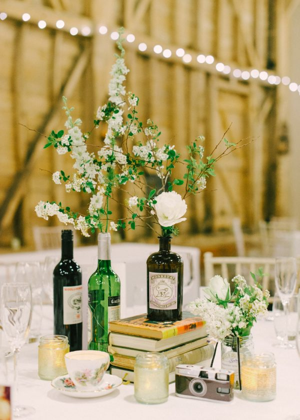 gin bottles as vases available from @theweddingomd rockmywedding.co.cuk - hannahduffy.com