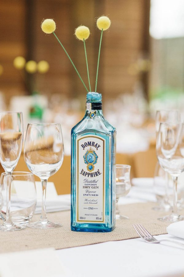gin bottles as vases available from @theweddingomd rocknrollbride.com - pauljosephphotography.co.uk