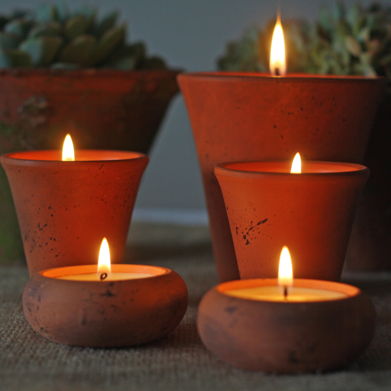 terracotta pots with candles