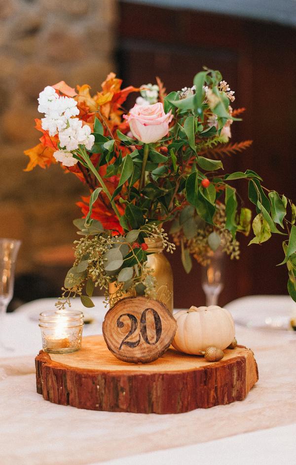 pumpkin wedding centrepieces on tree slices  ruffledblog-com-danielcruzblog-com
