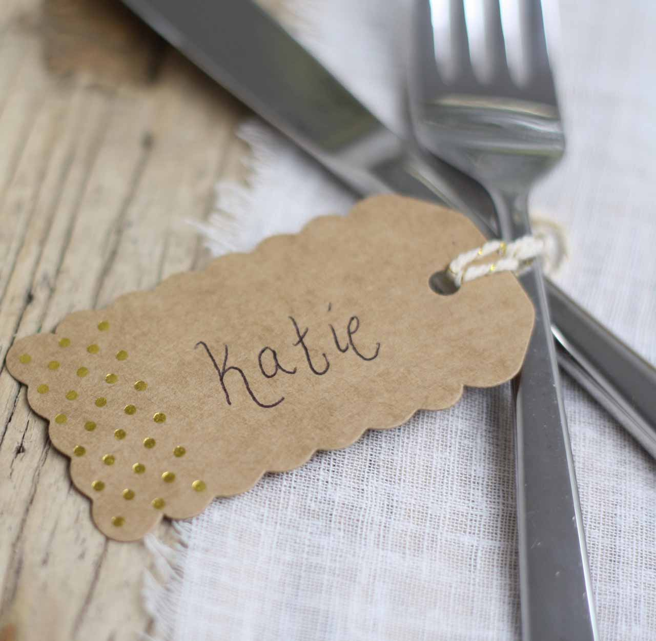 Brown kraft luggage tags with gold polka dots available from @theweddingomd