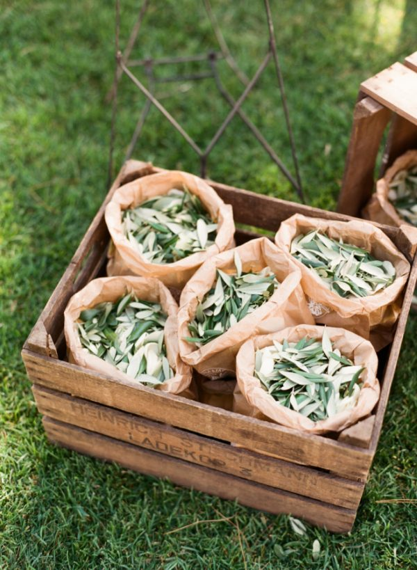 brown paper bags filled with olive leaves wedding confetti idea Italy