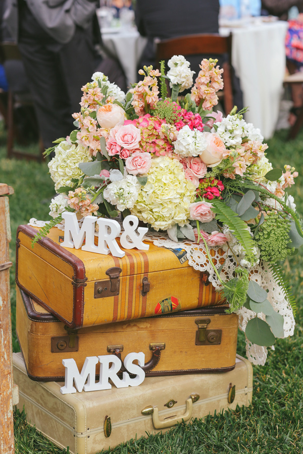 suitcases at your wedding Ruffled - photo by http://www.priscilavalentina.net/ - http://ruffledblog.com/bohemian-wedding-at-secluded-garden-estate