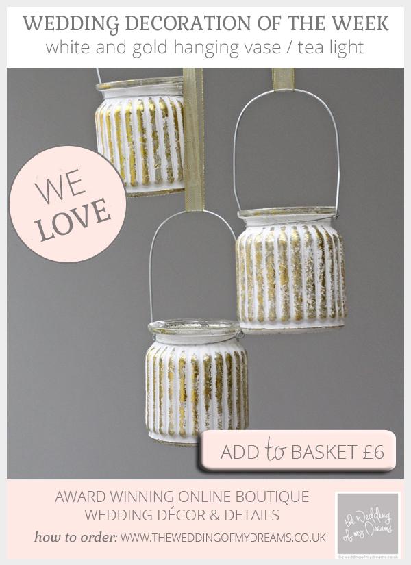 Elegant white and gold hanging vases tea lights available from @theweddingomd
