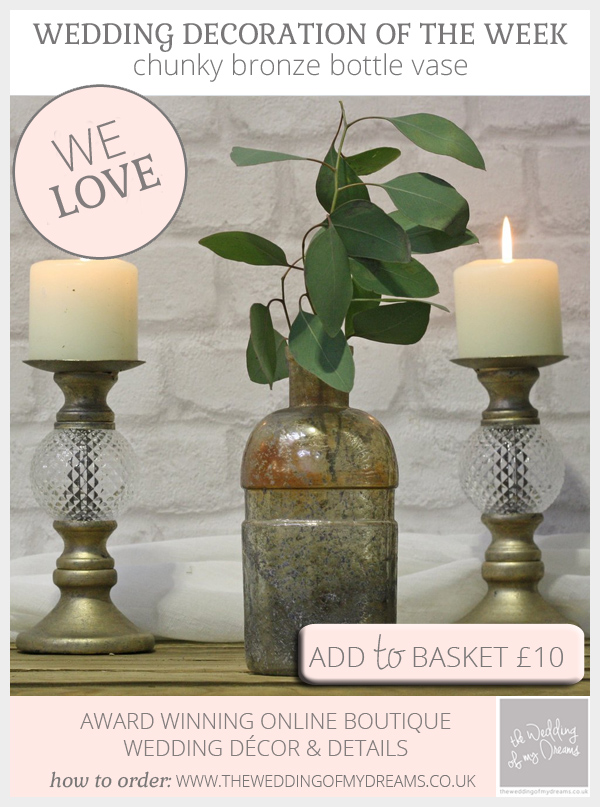 Chunky bronze bottle vase available from @theweddingomd