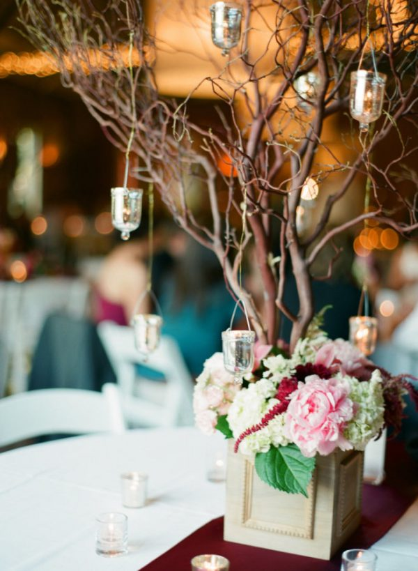 winter wedding centrepieces twigs branches with hanging tea lights