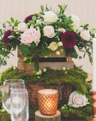 Featured Image wooden-crate-centrepiece-with-moss-and-copper-wedding-decorations-available-from-theweddingomd