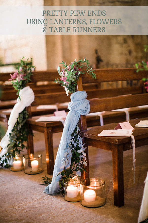 pretty ceremony pew ends using table runners lanterns and flowers click to see where to buy these.jpg
