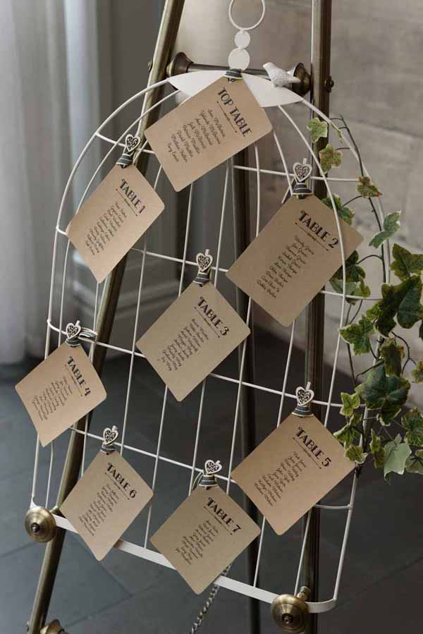 Pink Confetti Petals, Silver Candles & Love Is Sweet Favours Birdcage wedding table plan
