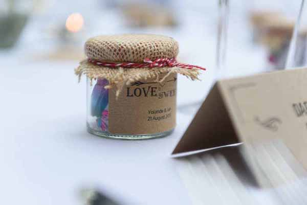 Pink Confetti Petals, Silver Candles & Love Is Sweet Favours Love is sweet wedding favours - stickers and jars @theweddingomd