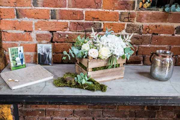 Real Weddings Using Our Small Wooden Crates Rustic small wooden crates of flowers guest book table at Shustoke Farm Barns - Lee Pallant Photography