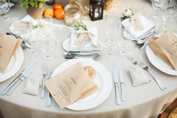 brown paper bag menus with fresh bread - rustic elegant alfresco wedding