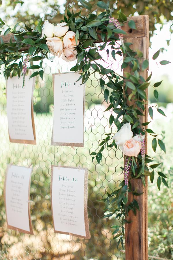 wedding table plan chicken wire frame floral garland