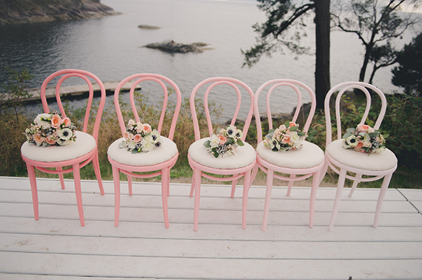 pretty bouquets on chairs wedding