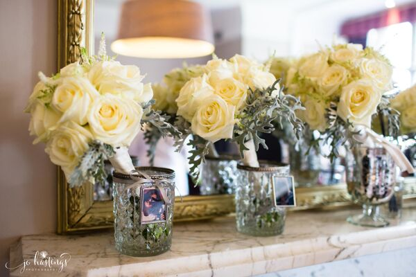wedding bouquets in glass vases