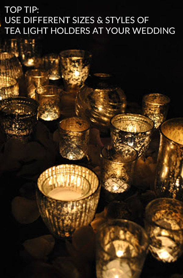 use different sizes and styles of tea light holders weddings