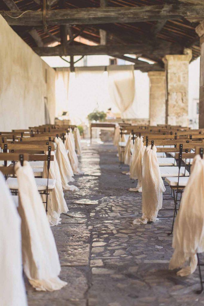 Outdoor wedding ceremony aisle decorations
