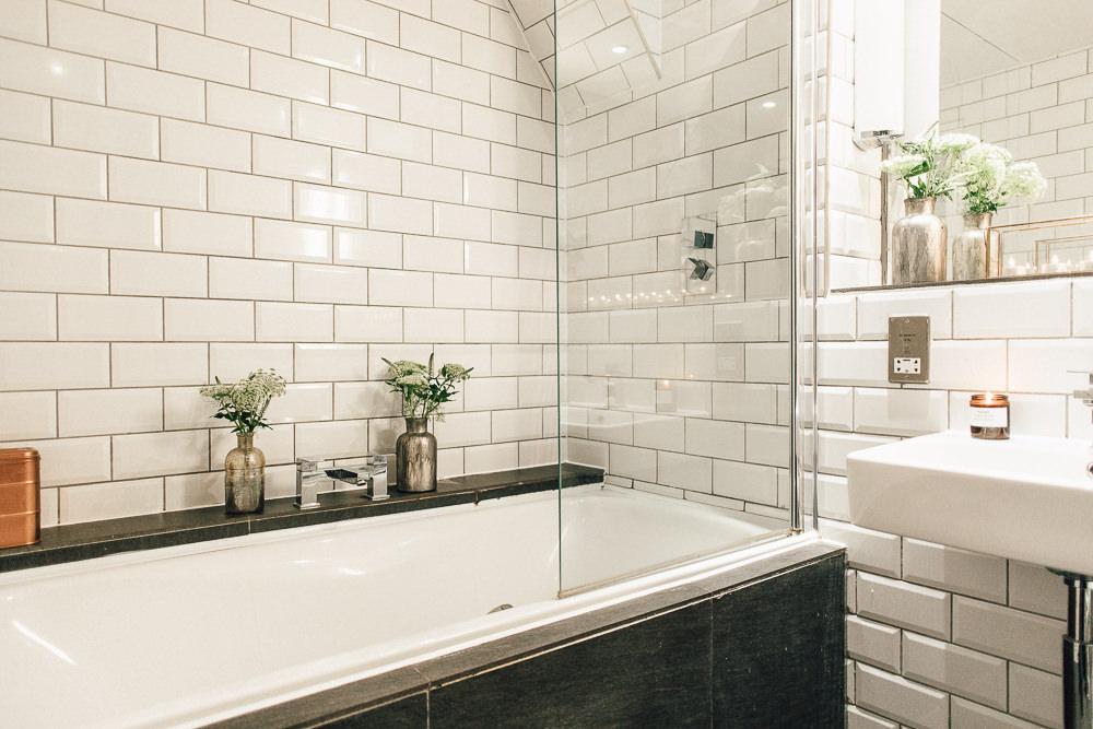 Industrial Living loft apartment bathroom subway tiles slate copper