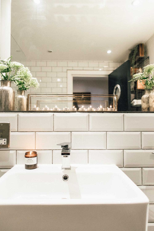 Industrial Living loft apartment sink subway tiles