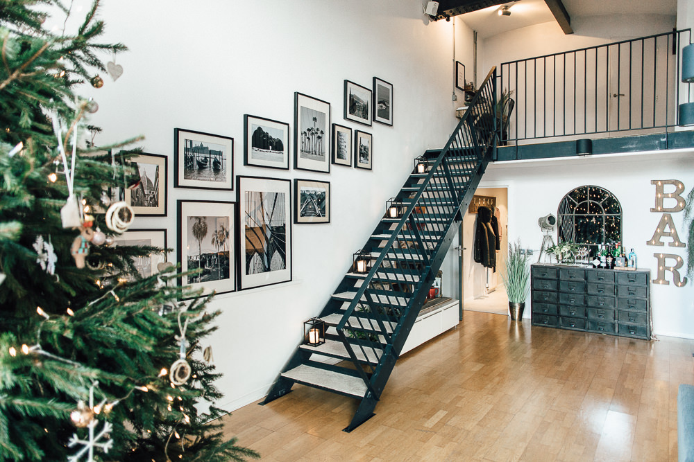 Industrial Living loft apartment stairs gallery wall