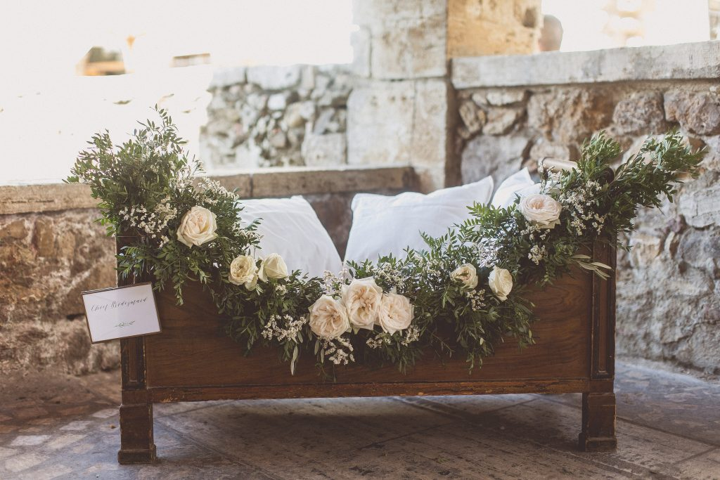 Flower girls cot wedding cermony ideas floral garland by Passion for Flowers destination wedding Tuscany