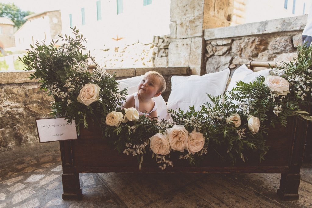 Flower girls wedding ideas cot with flower garland Passion for Flowers Bagno Vignoni Tuscany