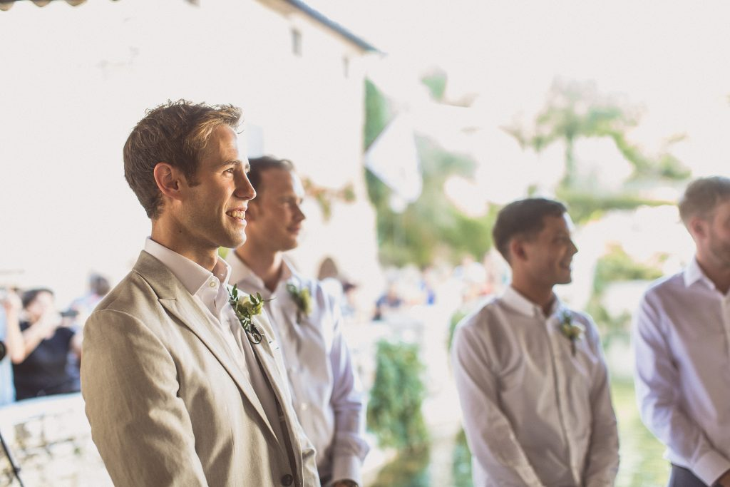 Groomsmen grey jackets chinos Tuscany wedding