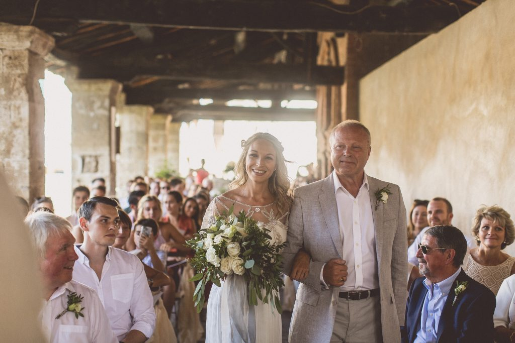 Outdoor wedding ceremony destination wedding Bagno VIgnoni Tuscany