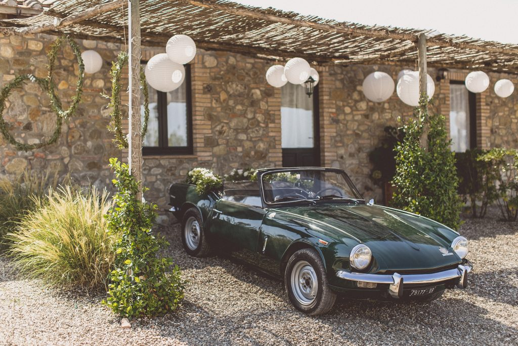 green vintage sports car wedding car Italy Locanda In Tuscany