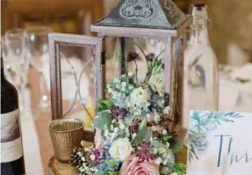 rustic wedding centrepiece for barn tree slices featured