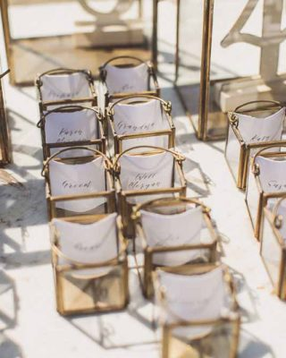 wedding escort cards brass lanterns 3