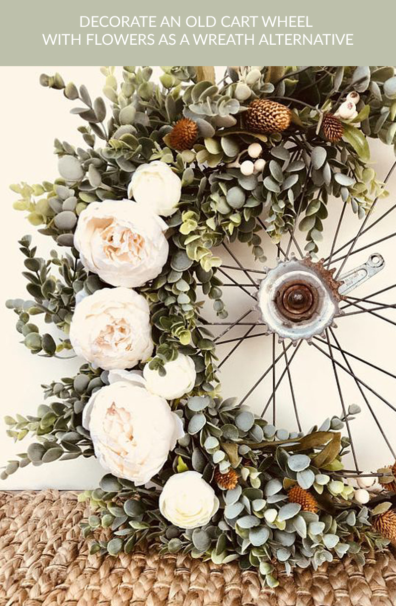 old cart wheels decorated with flowers wreath alternative rustic wedding buy rustic cart wheels The Wedding of my Dreams