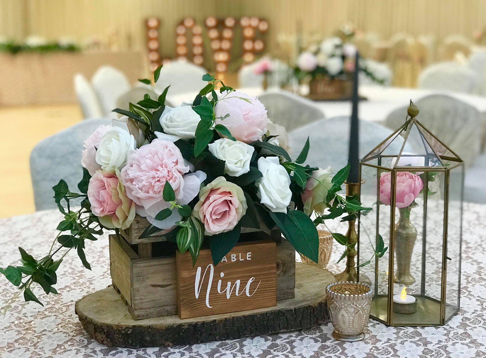 Rustic wedding centrepieces wooden crate on tree slices