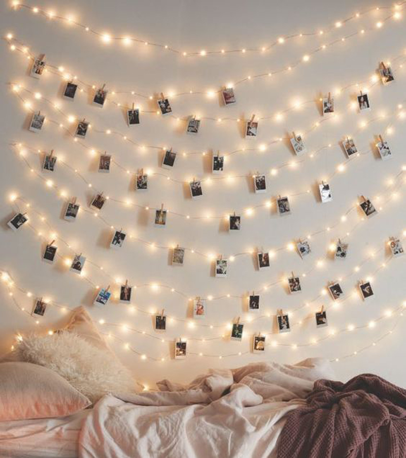 Wedding photo displays LED lights pegs and polaroid cameras