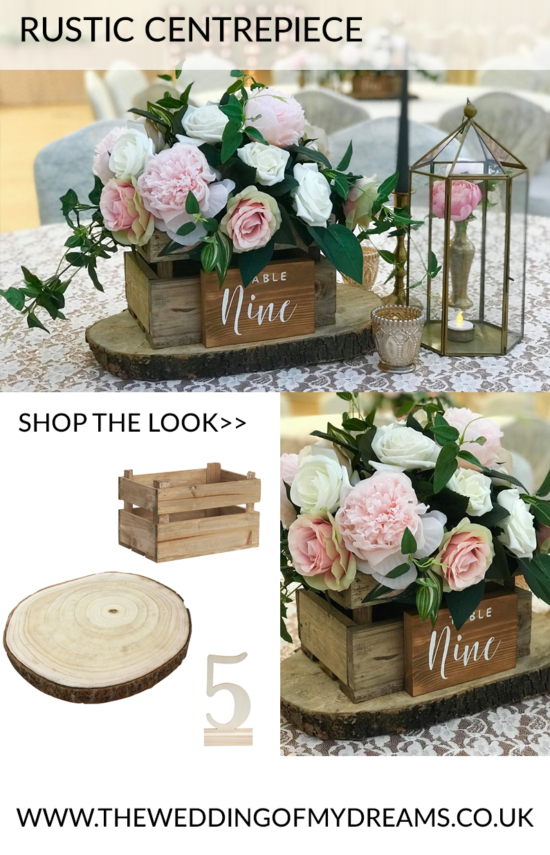 rustic wedding centrepieces wooden box of flowers tree stumps