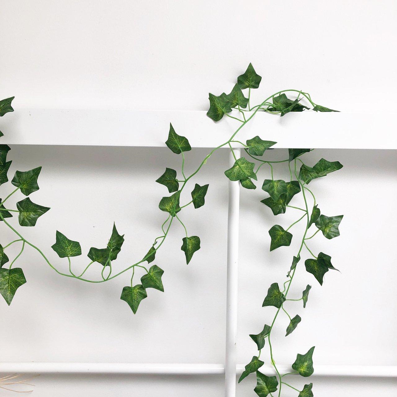 Decorative ivy garland decorate barn beams wedding venues