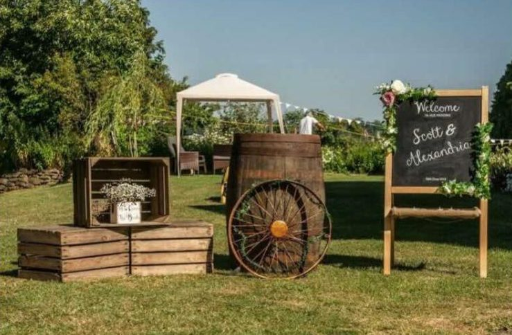 Rustic wedding styling with old cart wheels wagon wheels