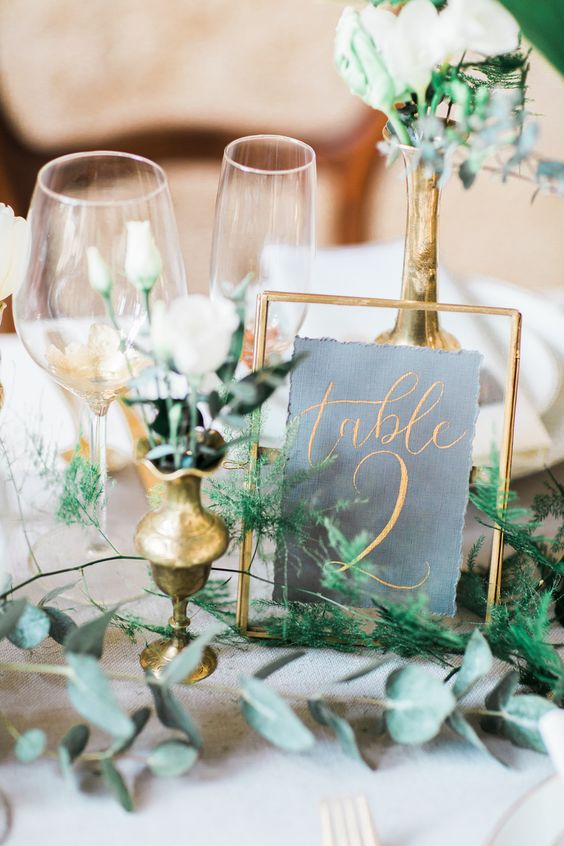 brass frames wedding table numbers with brass bud vases wedding styling
